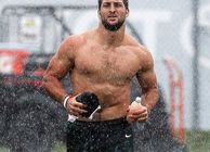 Tim Tebow running in rain