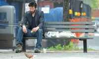 Article_list_keanu_reeves_sitting_alone_on_bench