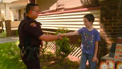 Cleveland police officer replaces kid's stolen Pokemon card collection with his own / photo credit: Rohan Trace, YouTube