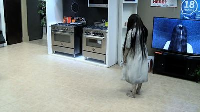 Watch people get terrified by an IRL 'The Ring' girl prank
