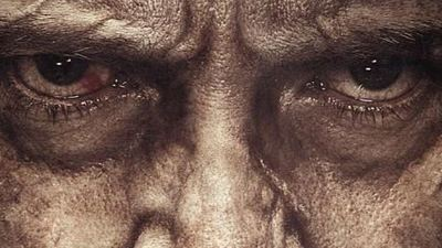 Hugh Jackman shows off the latest poster for 'Logan'